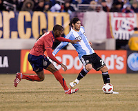 Ever Banega, Maurice Edu. The USMNT tied Argentina, 1-1, at the New Meadowlands Stadium in East Rutherford, NJ.