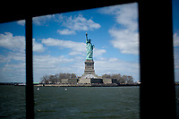 The Statue of Liberty is seen from a ferry on Saturday, April 5, 2014, on the Hudson River in New York. (Photo by James Brosher)