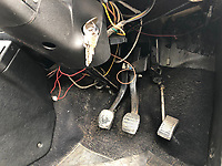 BNPS.co.uk (01202) 558833. <br /> Pic: Charterhouse/BNPS<br /> <br /> Pictured: Wiring could do with a tidy up. <br /> <br /> A clapped-out Ford Escort which has been languishing in a garage for nearly 25 years is tipped to sell for £25,000.<br /> <br /> The rare 1975 Mk 1 RS2000 model is in a rusty state and is in need of lots of care and attention.