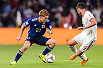 Doan Ritsu of Japan (L) fights for the ball with Milad Mohammadikeshmarzi of Iran (R) during the AFC Asian Cup UAE 2019 Semi Finals match between I.R. Iran (IRN) and Japan (JPN) at Hazza Bin Zayed Stadium  on 28 January 2019 in Al Alin, United Arab Emirates. Photo by Marcio Rodrigo Machado / Power Sport Images