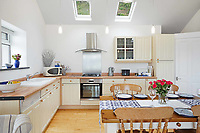 BNPS.co.uk (01202) 558833.<br /> Pic: MarchandPetit/BNPS<br /> <br /> Pictured: The kitchen.<br /> <br /> A cute cottage cut into the cliffside with spectacular views along a three-mile stretch of beach is on the market for £500,000.<br /> <br /> Unlike most coastal properties in the area, Boathouse Cottage does not look out to sea but along the popular beach.<br /> <br /> The quirky holiday home is in the picturesque village of Torcross, Devon, right next to Slapton Sands.