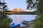 Mt. Adams, a stratovolcano towering over 12,000 feet in the Cascade Mountain Range of Washington State, USA, is reflected in Lake Takhlakh, in the Gifford Pinchot National Forest.  Mt. Adams is located just 31 miles east of Mt. St. Helens. Represented exclusively at www.spacesimages.com.