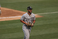 OAKLAND, CA - OCTOBER 1:  José Abreu #79 of the Chicago White Sox smiles while walking off the field against the Oakland Athletics during Wild Card Round Game Three at the Oakland Coliseum on Thursday, October 1, 2020 in Oakland, California. (Photo by Brad Mangin)