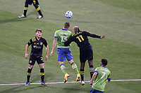 COLUMBUS, OH - DECEMBER 12: Jordan Morris #13 of the Seattle Sounders FC and Gyasi Zardes #11 of the Columbus Crew challenge for a header during a game between Seattle Sounders FC and Columbus Crew at MAPFRE Stadium on December 12, 2020 in Columbus, Ohio.