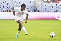KANSASCITY, KS - JULY 11: Richie Laryea #22 of Canada passes the ball during a game between Canada and Martinique at Children's Mercy Park on July 11, 2021 in KansasCity, Kansas.