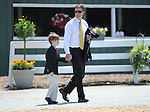 Trainer of Kentucky Derby Winner Animal Kingdom, Graham Motion arrives with his son Chappy on Preakness Day at Pimlico Race Course in Baltimore, Maryland on May 21, 2011