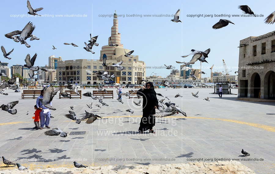 QATAR, Doha, spiral mosque, Fanar, Qatar Islamic Culture Center, here christians migrant worker can be converted to muslim, muslim qatari woman with asian house maid /  KATAR, Doha, Moschee und FANAR (Qatar Islamic Cultural Center), qatarische Frau mit Kindermaedchen