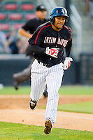 Jean Almanzar (10) of the Kannapolis Intimidators hustles down the first base line against the Hagerstown Suns at CMC-Northeast Stadium on May 17, 2013 in Kannapolis, North Carolina.  The Suns defeated the Intimidators 9-7.   (Brian Westerholt/Four Seam Images)