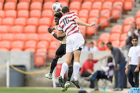 Houston, TX - Friday December 11, 2016: Adam Mosharrafa (16) of the Stanford Cardinal wins a header over Ema Twumasi (22) of the Wake Forest Demon Deacons at the NCAA Men's Soccer Finals at BBVA Compass Stadium in Houston Texas.