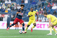 FOXBOROUGH, MA - AUGUST 4: Tajon Buchanan #17 of New England Revolution on the attack as Dave Romney #4 of Nashville SC defends during a game between Nashville SC and New England Revolution at Gillette Stadium on August 4, 2021 in Foxborough, Massachusetts.