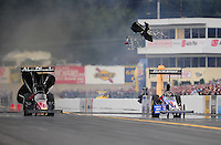 Oct. 1, 2011; Mohnton, PA, USA: NHRA top fuel dragster driver Bruce Litton (right) loses a parachute alongside Rod Fuller during qualifying for the Auto Plus Nationals at Maple Grove Raceway. Mandatory Credit: Mark J. Rebilas-