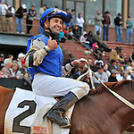 Jockey Joe Bravo gives a thumbs up after riding Junebugred to victory in the 5th running of the Smarty Jones stakes Monday afternoon at Oaklawn Park in Hot Springs, Arkansas.