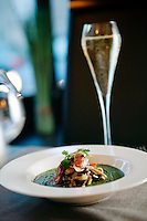 A risotto of spinach puree, seasonal mushrooms and grilled bacon is served as a starter at L'Armoise restaurant, Antibes, France, 07 April 2012