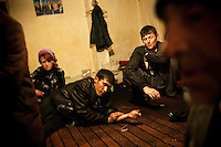 Drug addicts just after injecting themselves with a dose of heroin. In Osh, a single dose of heroin costs less than 2 Euros, which is less than the cost of a beer.
