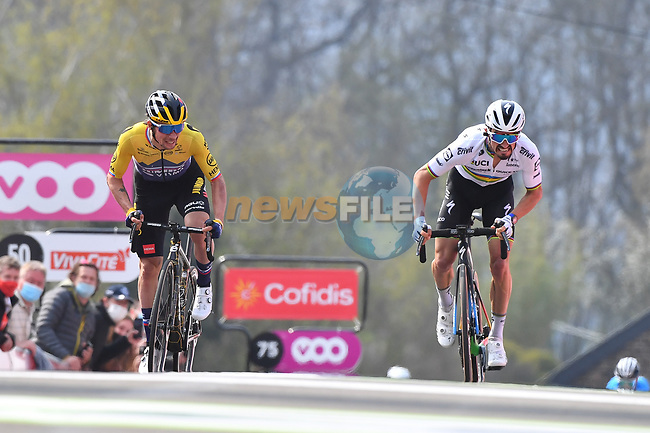 Slovenian Champion Primoz Roglic (SLO) Jumbo-Visma and World Champion Julian Alaphilippe (FRA) Deceuninck-Quick Step battle for the win on the final climb of the Mur de Huy during the 2021 Flèche-Wallonne, running 193.6km from Charleroi to Huy, Belgium. 21st April 221.  <br /> Picture: Serge Waldbillig | Cyclefile<br /> <br /> All photos usage must carry mandatory copyright credit (© Cyclefile | Serge Waldbillig)
