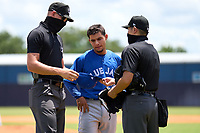 FCL Blue Jays pitcher Guillermo Villasmil (20) gets checked for foreign substances by umpires Chase Eubanks and Takashi Wada during a game against the FCL Yankees on June 29, 2021 at the Yankees Minor League Complex in Tampa, Florida.  (Mike Janes/Four Seam Images)