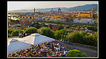 Italy, Florence.   <br /> This shot looks simpler than it is. There are 40 people in frame and they all look good-not easy. Create a nice composition and wait for the decisive moment. Plus, I've utilized strong diagonal lines, with the tent, fence and river. <br />  Getting the most out of a hazy sunset at Michel Angelo Square and restaurant, Florence, Italy.