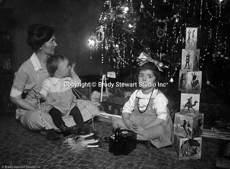 Wilkinsburg PA:  Sarah, Brady Jr, and Helen Stewart checking out the toys under the Christmas Tree.
