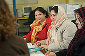 Women attend an English language class at Queens Park Library, London