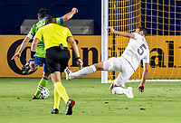 CARSON, CA - SEPTEMBER 27: Daniel Steres #5  of the Los Angeles Galaxy attempts a tackle Nicolas Lodeiro #10 of the Seattle Sounders during a game between Seattle Sounders FC and Los Angeles Galaxy at Dignity Heath Sports Park on September 27, 2020 in Carson, California.
