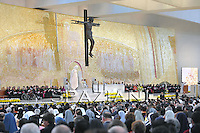 Pope Benedict XVI (C, back) attends the Vespers celebrations at the Church of the Most Holy Trinity in Fatima, on May 12, 2010. Half a million people flocked to a giant mass with Pope Benedict XVI in Portugal on May 13 in what the Church said was a massive show of support for his handling of the paedophile priest crisis