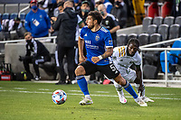 SAN JOSE, CA - MAY 15: Eric Remedi #5 of the San Jose Earthquakes looks up to pass the ball during a game between San Jose Earthquakes and Portland Timbers at PayPal Park on May 15, 2021 in San Jose, California.
