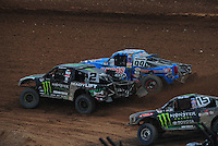 Mar. 20, 2011; Chandler, AZ, USA;  LOORRS pro two driver Jeremy McGrath (2) races inside of Robby Woods (99) during round two at Firebird International Raceway. Mandatory Credit: Mark J. Rebilas-