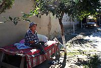 """ROMANIA, Tulcea, Viitorului Street, 2010/08/24.Half of the Roma families living in the district of Tulcea Viitorului, bordering the former industrial conglomerate, lives in France. This area is one of the poorest in the city without running water and sometimes no electricity. The street of """"future"""" is always paved. The families live mainly social benefits and hope all from one day to join Roma in Saint-Denis France)..© Bruno Cogez / Est&Ost Photography..Roumanie, Tulcea, quartier de Viitorului, 24/08/2010.La moitié des familles roms vivant dans le quartier Viitorului de Tulcea, en bordure de 'lancien combinat industriel, vit en France. Ce quartier est un des plus pauvre de la ville, sans eau courante et parfois sans électricité. Les familles vivent principalement des allocations sociales et espèrent toutes partir un jour rejoindre les Roms de Saint-Denis..© Bruno Cogez / Est&Ost Photography"""