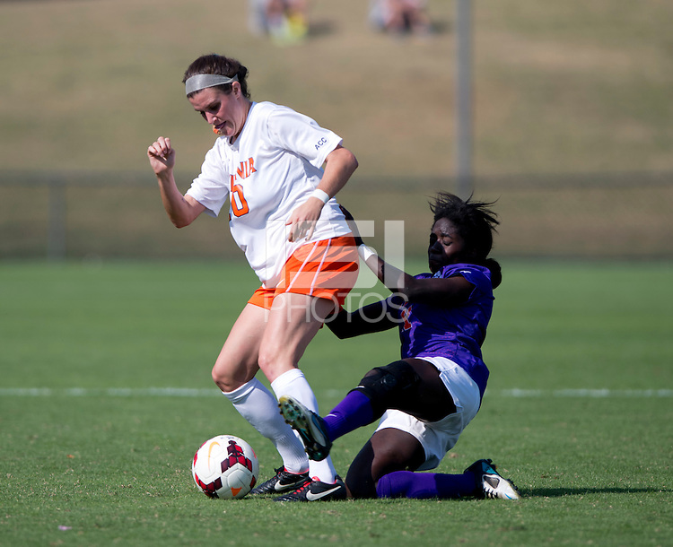 Annie Steinlage (10) of Virginia is fouled by Catrina Atanda (11) of Clemson at Klockner Stadium in Charlottesville, VA.  Virginia defeated Clemson, 3-0.