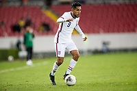 GUADALAJARA, MEXICO - MARCH 24: Jesus Ferreira #9 of the United States races with the ball during a game between Mexico and USMNT U-23 at Estadio Jalisco on March 24, 2021 in Guadalajara, Mexico.