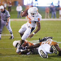 04 November 2006: Cowboys running back Keith Toston (#5) tries to escape a tackle by Texas defenders during the Longhorns 36-10 victory over the Oklahoma State University Cowboys at Darrel K Royal Memorial Stadium in Austin, Texas.