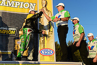 Nov. 11, 2012; Pomona, CA, USA: NHRA funny car driver Jack Beckman (left) celebrates with crew chief Todd Smith after clinching the 2012 championship during the Auto Club Finals at at Auto Club Raceway at Pomona. Mandatory Credit: Mark J. Rebilas-