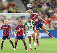 AUSTIN, TX - JUNE 16: Lindsey Horan #9 of the United States heads the ball over Rasheedat Ajibade #15 of Nigeria during a game between Nigeria and USWNT at Q2 Stadium on June 16, 2021 in Austin, Texas.