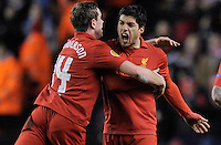 21.02.2013 Liverpool, England. Luis Suarez  of Liverpool celebrates with Jorand Henderson after scoring during the Europa League game between Liverpool and Zenit St Petersburg from Anfield. Liverpool won 3-1 on the night but went out of the competition on away goals.