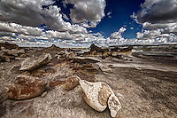 A wider view of the formation that includes the Bisti Arch and some of the other formations close by in Alamo Wash in the Bisti Wilderness of northwest New Mexico.