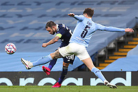 3rd November 2020; City of Manchester Stadium, Manchester, England. UEFA Champions League group stages, Manchester City versus Olympiacos;  Mathieu Valbuena (OL) takes a shot on goal past John Stones Manchester City