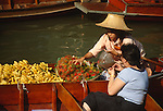 Ratchaburi has lots of places to visit and the most popular tourist attraction is Damnoen Saduak Floating Market. It is an identity of Ratchaburi and is also well known around the world. Damnoen Saduak Floating Market is in the Damnoen Saduak district.[8] It shows the people's life style and the importance of the river as a mean of commerce. The vendors would paddle their boats up and down the waterways selling and bartering their merchandise. Their faces are often shielded from the strong rays of the sun by hats made from bamboo and palm leaves.[9] The markets start in very early morning until 11:00 A.M. Nowadays, many tourists from around the world come to visit because it shows an old fascinating style traditions. That is why the Damnoen Saduak Floating Market became the top ten famous places in Thailand.