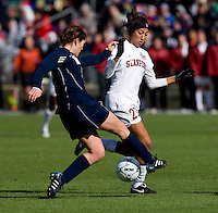 Christen Press (23) of Stanford is tackled by Molly Campbell (5) of Notre Dame during the final of the NCAA Women's College Cup at WakeMed Soccer Park in Cary, NC.  Notre Dame defeated Stanford, 1-0.