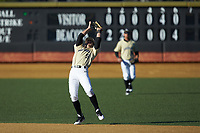 Wake Forest Demon Deacons shortstop Patrick Frick (5) catches a pop fly during the game against the Gardner-Webb Runnin' Bulldogs at David F. Couch Ballpark on February 18, 2018 in  Winston-Salem, North Carolina. The Demon Deacons defeated the Runnin' Bulldogs 8-4 in game one of a double-header.  (Brian Westerholt/Four Seam Images)