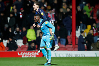 Brice Samba of Nottingham Forest and Matty Cash celebrate during the Sky Bet Championship match between Brentford and Nottingham Forest at Griffin Park, London, England on 28 January 2020. Photo by Carlton Myrie.