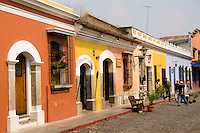 Colorful street scene with cobblestone at 8th Ave Calle in tourist village of Antigua Guatemal