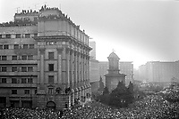 ROMANIA, Pta. Palatului, today Pta. Revolutiei, Bucharest, 22.12.1989<br /> People rise against Ceausescu. After the Ceausescu couple has fled by helicopter around noon, protestors fill the square which originally was guarded by tanks. They aim at the Communist Party Central Committee building. Its balcony is climbed, revolutionary speeches are made. Kretzulescu church.<br /> © Andrei Pandele / EST&OST