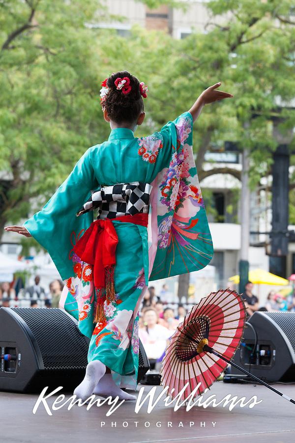 Beautiful Asian girl wearing colorful blue Japanese Kimono, Dragon Fest 2015, Chinatown, Seattle, Washington, USA.