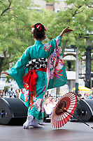 Beautiful Asian girl wearing colorful blue Japanese Kimono, Dragon Fest 2015, Chinatown, Seattle, Washington, USA.