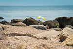 Hammonasset Beach State Park, Madison, CT. Reading among the rocky shoreline. Meigs Point