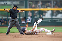 Virginia Cavaliers shortstop Daniel Pinero (22) maintains contact with second base as he is called safe by umpire Mike Morris against the Arkansas Razorbacks in Game 1 of the NCAA College World Series on June 13, 2015 at TD Ameritrade Park in Omaha, Nebraska. Virginia defeated Arkansas 5-3. (Andrew Woolley/Four Seam Images)