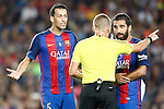 FC Barcelona's Sergio Busquets (l) and Arda Turan (r) have words with the referee during Supercup of Spain 2nd match.August 17,2016. (ALTERPHOTOS/Acero)