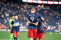 FOXBOROUGH, MA - MAY 22: Adam Buksa #9 of New England Revolution celebrates his goal with Gustavo Bou #7 of New England Revolution who assisted during a game between New York Red Bulls and New England Revolution at Gillette Stadium on May 22, 2021 in Foxborough, Massachusetts.