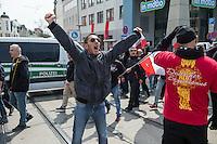 Ca. 1000 Nazis aus ganz Deutschland marschierten am Sonntag den 1. Mai 2016 im Saeschsichen Plauen auf. Die Naziorganisation 3.Weg hatte den Marsch angemeldet. Etliche Nazis waren dabei vermummt und zeigten auch den Hitlergruss, die Polizei schritt jedoch nicht ein.<br /> Nach der Haelfte der Marschroute beendeten die Nazis ihre Demonstration, da die Polizei die Marschroute verkuerzen wollte. Sie forderten die Polizei auf den Weg freizugeben. Danach griffen Aufmarschteilnehmer die Polizei an, die daraufhin Wasserwerfer, Pfefferspray, Traenengas und Schlagstoecke einsetzte. Mehrere Gruppen Nazis zogen danach durch Plauen und jagten Menschen.<br /> Nach einer Stunde bekamen die Nazis einen erneuten Aufmarsch von der Polizei genehmigt und zogen zurueck zum Bahnhof.<br /> Im Bild: Nazis beleidigen Gegendemonstranten und Buerger, die an der Marschroute standen.<br /> 1.5.2016, Plauen<br /> Copyright: Christian-Ditsch.de<br /> [Inhaltsveraendernde Manipulation des Fotos nur nach ausdruecklicher Genehmigung des Fotografen. Vereinbarungen ueber Abtretung von Persoenlichkeitsrechten/Model Release der abgebildeten Person/Personen liegen nicht vor. NO MODEL RELEASE! Nur fuer Redaktionelle Zwecke. Don't publish without copyright Christian-Ditsch.de, Veroeffentlichung nur mit Fotografennennung, sowie gegen Honorar, MwSt. und Beleg. Konto: I N G - D i B a, IBAN DE58500105175400192269, BIC INGDDEFFXXX, Kontakt: post@christian-ditsch.de<br /> Bei der Bearbeitung der Dateiinformationen darf die Urheberkennzeichnung in den EXIF- und  IPTC-Daten nicht entfernt werden, diese sind in digitalen Medien nach §95c UrhG rechtlich geschuetzt. Der Urhebervermerk wird gemaess §13 UrhG verlangt.]