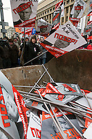 "Moscow, Russia, 13/01/2013..Protesters throw portraits of Russian politicians into a skip marked ""for garbage"". Thousands of opposition protesters carried posters of President Vladimir Putin and members of the Russian parliament with the word ?Shame? written in red at a protest called the March Against The Scoundrels. The protest was against the new law banning the adoption of Russian children by Americans, widely seen as a response to the recently passed USA Magnitsky Act."
